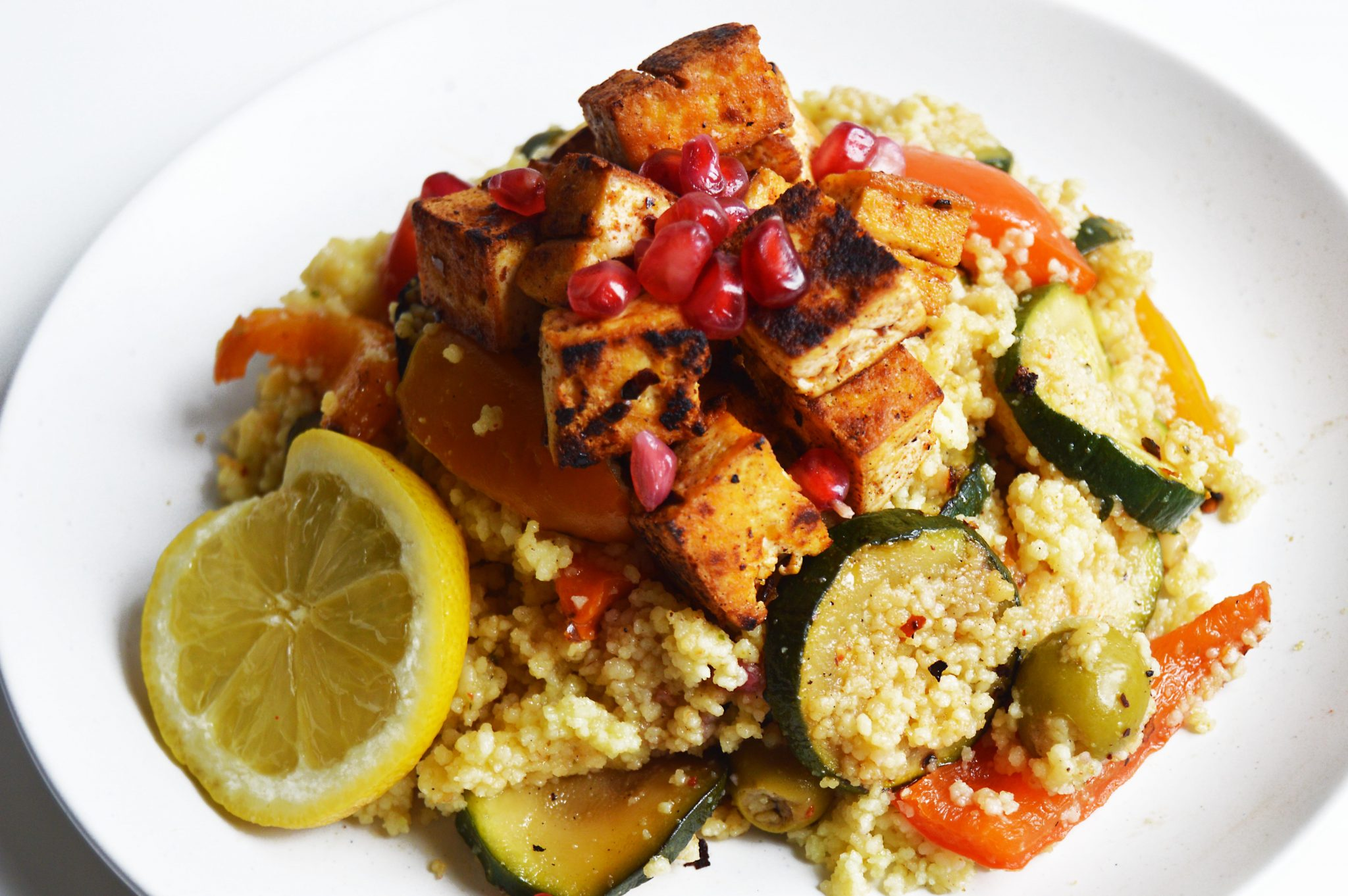Vegan Couscous Salad with Crispy Fried Tofu and Pomegranate Seeds